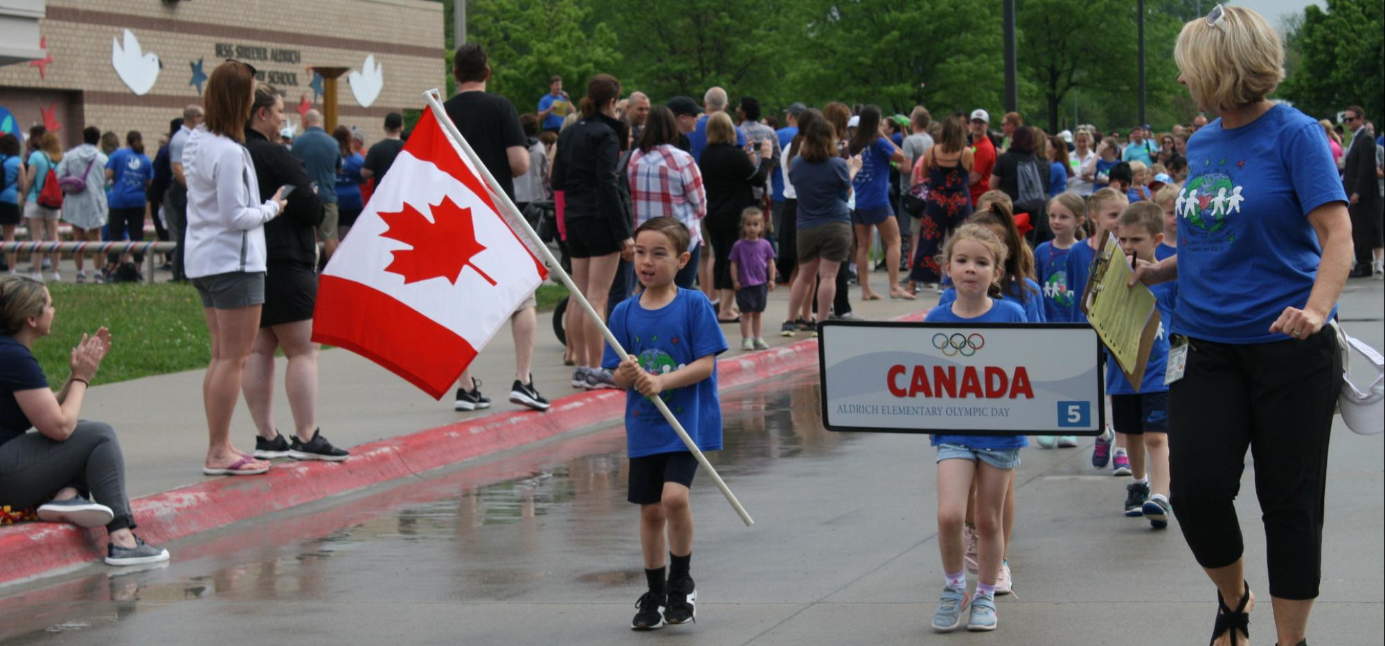 Student carrying Canada flag